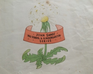 picture of a dandelion flower with inscription
